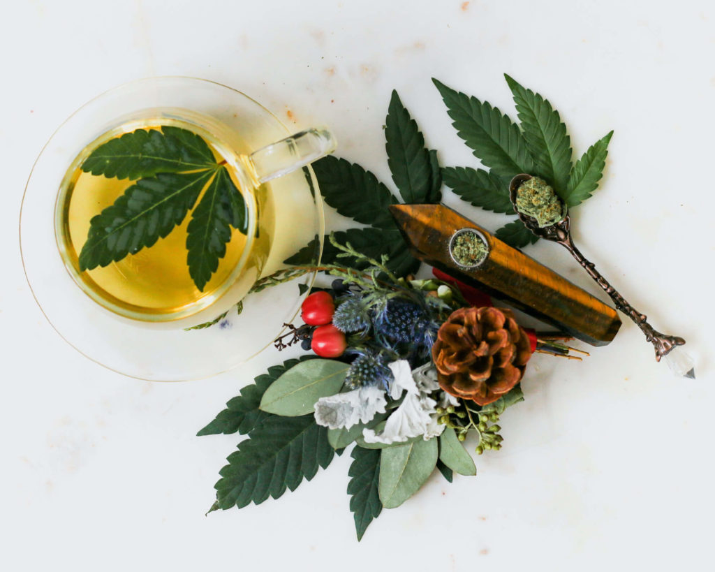 Image of CBD oil, hemp flower, hemp leaves
